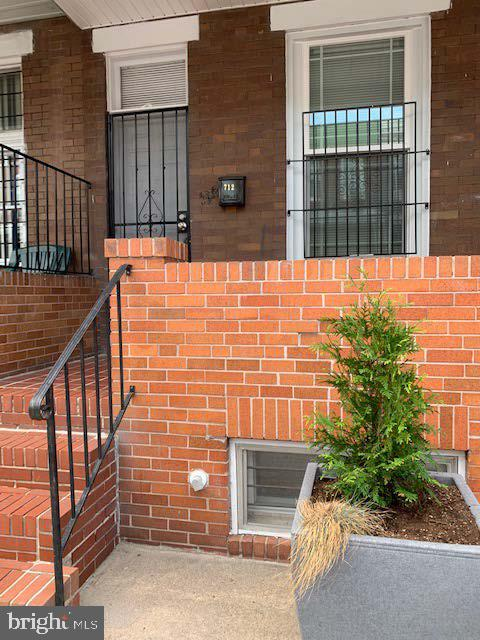 This is a magnificently renovated 3 bed/3.5 bath YOU will be delighted to call home. Living room is enhanced with 9 feet ceiling and natural exposed polished brick.  Master bedroom is equipped with it's own master bath, adorned with Italian marble floor, jacuzzi with shower, and satin finished highly durable fixtures. The kitchen is immaculate with granite counter top, high efficiency stove, refrigerator, dishwasher and microwave with 10 year manufacturer's warranty. Fully finished basement with legal bedroom, full bath and sump pump, plus extra room for office or playroom. Privacy is provided with fenced and concrete slabbed backyard. Seller will redeem ground rent at settlement. Opportunity to capitalize on Vacant to Value and Live near your work incentives. Easy access to public transportation, rte 40, 1-695 and 1-95, Johns Hopkins University, Patterson Park, Restaurants, Churches, schools, shopping and downtown Inner Harbor.