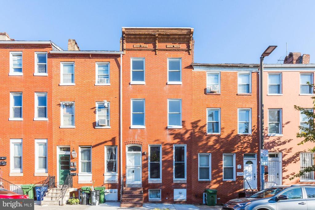 4BR/2.5BA 4-level all-brick rowhome in the desirable Hollins Market area! Walking distance to UMAB, Restaurants, Camden Yards, M&T Stadium and convenient to 95 and 295. This home is very spacious w/ 4BRs spread out over two upper floors & fully finished basement. Private rear exterior space is perfect!