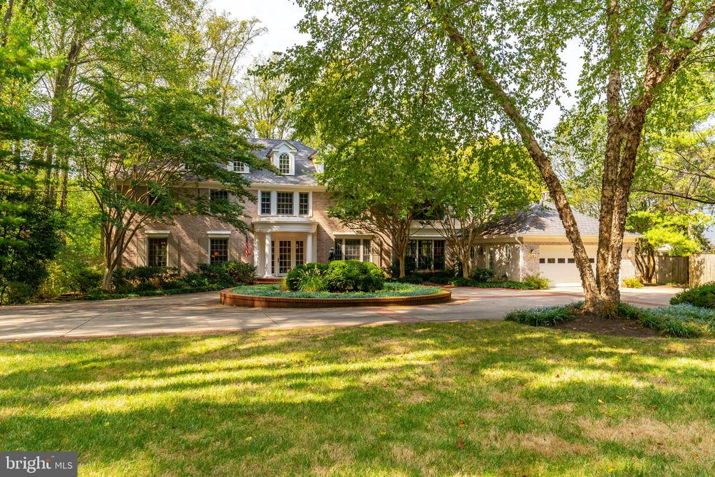 Open Sunday 11/24 from 2-4 PM! Your own private oasis in Bethesda. Surrounded by mature trees, and set back from the main street, you will love the refuge this estate offers. Features an award winning kitchen by Jennifer Gilmer, cherry paneled library, stunning owner's suite with marble bath and private screened porch, and lush grounds with swimming pool and circular driveway. An elegant retreat in sought-after Longwood neighborhood.
