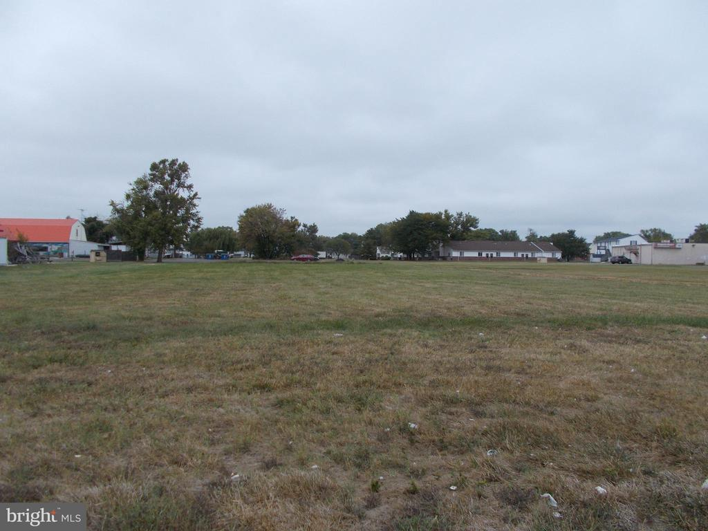"New price on this commercial lot in Cambridge. Located just off Rt. 50-Rt. 50 visibility without Rt. 50 pricing.  1.16 +/-  acre lot with commercial zoning allowing many commercial endeavors.  Cambridge is the Shore's new ""Hot spot"" move your business or invest now!"