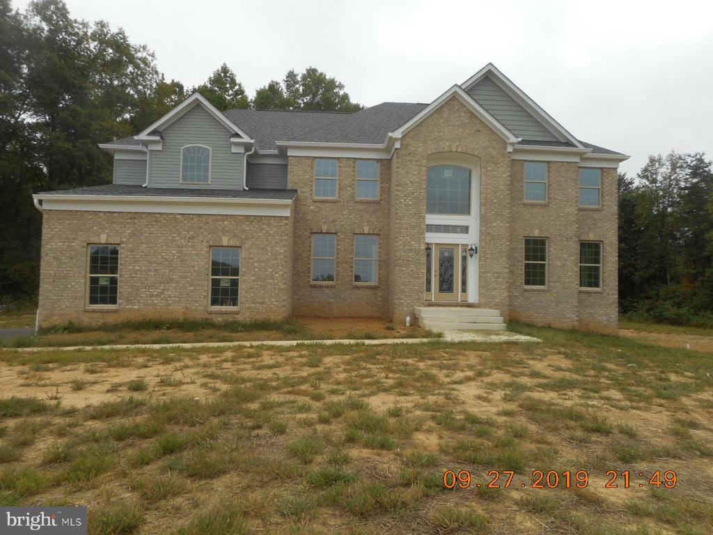 PRICE REDUCED!!!!FANTASTIC NEW HOME ON 7 ACRES IN UPPER MARLBORO!! HOME HAS OVER 6,000 SQ FT OF FINSISHED SPACE!! THE ENTRY FOYER IS AN ASTOUNDING 2 STORY FOYER. ON ONE SIDE IS AN OFFICE AND THE OTHER SIDE IS A LARGE LIVING ROOM. BEHIND THE LIVING ROOM IS A LARGE FORMAL DINING ROOM WITH CHAIR RAIL AND CROWN MOULDING!! THE KITCHEN IS A LAGRE ISLAND KITCHEN WITH A LARGE EAT IN AREA WITH AN ENTRY TO THE SUNROOM OVERLOOKING THE REAL PRIVATE YARD. NEXT IS THE FAMILY ROOM WITH A GAS LOG FIREPLACE. MOST OF THE FIRST FLOOR IS HARDWOOD WITH SOME CERAMIC TILE!! UPSTARS FEATURES 4 BEDROOMS AND 3 FULL BATHS. THE MASTER BEDROOM IS HUGE WITH 2 WALKING CLOSETS AND A LARGE SITTING AREA!! THE MASTER BATH HAS A LARGE TUB, SEPARATE SHOWER AND A TWO SINK VANITY.  THE FOYER FEATURES A 2 STORY STAIRCASE FINISHED WITH HARDWOOD STAIRS. THE BASEMENT IS COMPLETELY FINISHE WITH A LARGE REC ROOM A FULL BATH AND A BEDROOM!!  A THREE CAR ATTACHED GARAGE COMES OFF LAUNDRY ROOM AND 3 CARS SPACE FOR EXTRA PARKING!! THE LONG DRIVEWAY IS BLACKTOP!! THE WHOLE PACKAGE SITS ON A 7 ACRE PRIVATE PARCEL ON THE UPPER MARLBORO BORDER!! LOCATION IS PRIVATE AND VERY CONVENIENT TO ANNAPOLIS OR WASHINGTON D.C.! HOME IS UNDER CONSTRUCTION AND SHOWS WELL!! 10 YEAR WARRANTY CONVEYS AT SETTLEMENT! SETTLEMENT TO OCCUR AT TITLEMAX.