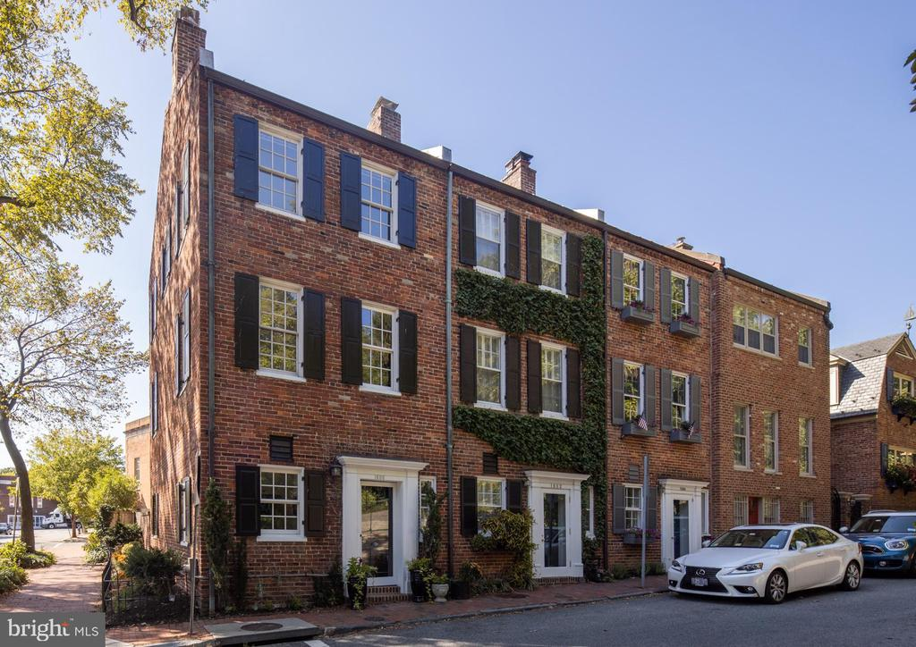 Welcome to the East Village of Georgetown!  Located across from Tudor Place, this attractive, all-brick, 3-level row house offers elegant and comfortable light-filled living space.  The entry level features a garden room/potential guest bedroom, powder room, and an updated kitchen with Ann Sacks tile, granite counters, stainless appliances plus laundry area.  The open second level can be used as a living room and dining room with fireplace and windows on 3 sides.  The home's top floor has two spacious bedrooms, a full bath, and access to an attic.  Other features include a private brick garden, high ceilings, newer windows, central air conditioning, hardwood floors and a convenient location.