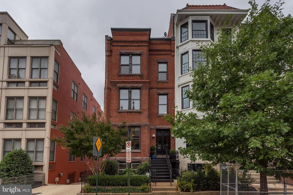 Open House on 10/19 and 10/20 from 1:00-4:00 pm. This end-unit, turnkey townhouse was built c. 1875 and offers four impeccable levels with incredible views of President Roosevelt's church, pristine original millwork, a surplus of natural light and windows in every room, professionally landscaped gardens with a patio and terrace, and two car parking. The main level offers a spacious living room with fireplace, dining room with fireplace, family room, gourmet kitchen with Sub-Zero, AGA cast iron gas range, granite counters, and a half-bath. The second level offers two large bedrooms that include generous closets, a huge bathroom with double sinks, soaking tub, separate shower, toilet closet, and a separate laundry room with storage.  The third level offers two grand bedrooms that include ample closet space, and a spa-like bathroom. The lower level offers a bright 1,180 sq. ft. English basement w/C of O, living room with fireplace, bedroom, office, full bathroom, and eat-in kitchen with laundry. This exquisite property is conveniently within a block of Whole Foods, CVS, Flow Yoga Center, Vida Fitness, Le Diplomat and all the amenities that the Logan Circle neighborhood offers.