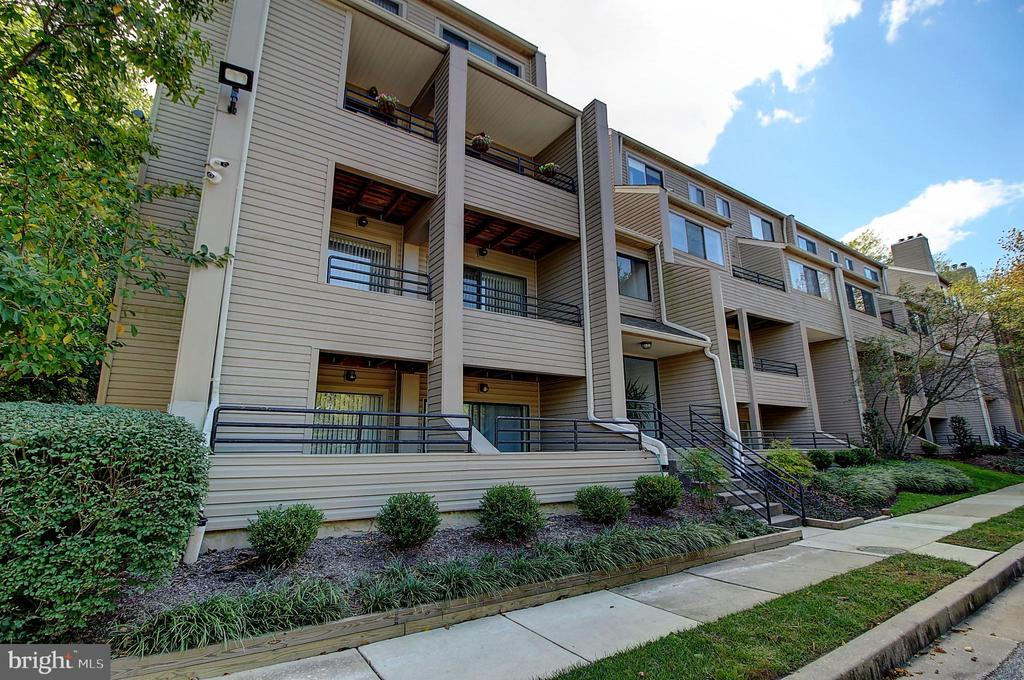 Beautifully redone  first floor 2 bedroom 1.5 bath unit.  Features include a  newer kitchen and remodeled baths, laminate flooring, private terrace, ample parking, washer / dryer in unit, and a great location. Call for a private showing today!