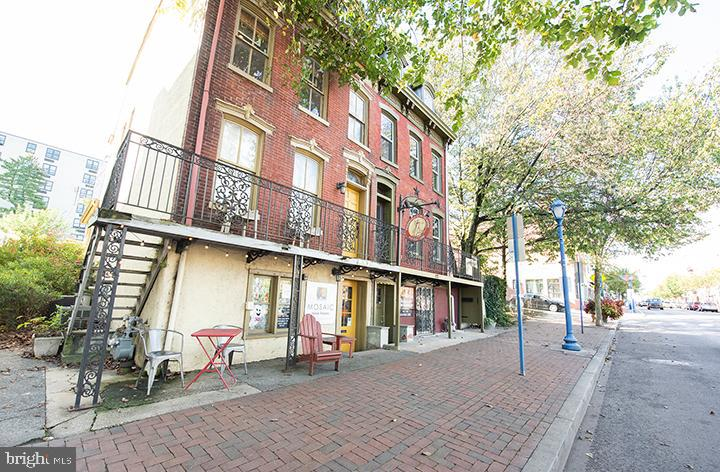 Beautiful brick 3-unit twin in amazing downtown location in the heart of Phoenixville: two apartments on upper levels and a ground-level commercial space. The location just doesn't get better than Bridge Street! The ground floor unit, at street level, is currently rented to a music lesson company. This commercial unit includes 3 offices/rooms, a powder room and kitchenette. The second unit on the main level is a 1 bedroom apartment with eat-in kitchen, living room, office space and bath. Enjoy views of the town from the wrought iron front porch. The 3rd unit is a 2 bedroom, 1.5 bath apartment on the 3rd floor and includes a spacious kitchen, living and dining area and two bedrooms. A spacious backyard and off-street parking complete the property. Live in one and rent the others or continue renting out all three units. Rents are currently below market value, with an additional $5000-$7000 in untapped income potential. Own a piece of Phoenixville's historic Bridge Street!
