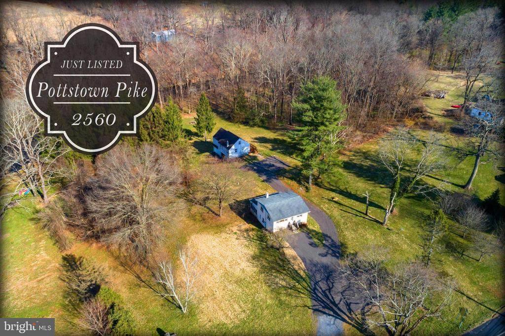 Owners ready to sell!!!  Elevation study has been completed.  Flood plain elevation certificate showing structure not in flood plain.  See attached documents.  Unique opportunity to own your own little slice of heaven. Two separate homes on over 3 acres backing up to French Creek. The rear home has been renovated and is ready for new owners. It consists of a 2 Bedroom home that has an open floor plan with large windows over looking French Creek, hardwood floors and an updated bathroom. Also featured is a 2 car garage under home with ample space for workshop. The front home is also a 2 bedroom and while in need of some updating, has good bones and would make a great rental or ~in-law~ suite. Property has over 600ft of creek frontage. Truly a rare find.....Rear home was rented through 9/2018 for $1,200/month.  Front home has been vacant for over 1 year.  Bedroom and bath totals are both homes combined.
