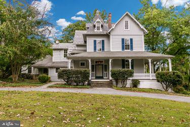 """Classic elegance! This grand Victorian home w/ 6 BR, 3 full & 1/2 on 1.23 acres is awaiting a special buyer. Wonderful wrap around porch overlooking green space. Huge FR just off kitchen w/ built ins that leads to outdoor patio. Sep DR overlooking backyard, LR w/ built ins & parlor w/ FP on main level. 3 BR on 2nd fl & 3 more BR on 3rd fl. Large rooms, high ceilings, beautiful wood floors, in very desirable Dixon Hill area of Mt Washington. Walking distance to the Village, light rail & Whole Foods. 3 zone CAC. Guest house can bring in extra income or great for an au pair. Selling """"as is"""" but in great condition. Property does have a conservation easement. Must see to truly appreciate."""