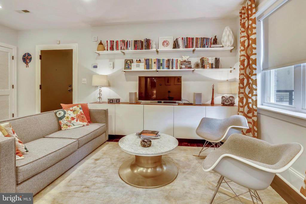 Bright and beautiful 2 bed, 2 bath in Shaw/Logan Circle. Spacious unit features and open concept living with hardwood floors and oversized windows. Gourmet kitchen with Quartz counters, breakfast bar seating and stainless steel appliances. Large master suite boasts a luxury bath and glass shower. Additional upgrades include Elfa systems in all three closets, blackout blinds installed throughout the apartment and a Nest thermostat system. Washer/dryer in unit. Pet-friendly building. and close to two metro stations. Only steps to Shaw's best restaurants, Giant, Kennedy Recreation center, Atlantic Plumbing Cinema and 9:30 Club. Close to Logan Circle/14th St dining, shops, and entertainment! Low condo fees.