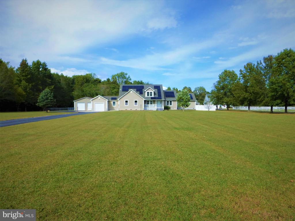 """Offered for the First Time by the Original Owners, this Comfortable Home rests Quietly on 4.65 Manicured Acres (2.5 AC fenced-in) partially wooded including a Stream, the Birch Branch Tributary! This is A VERY SAVVY BUY INDEED!! Country living, located within minutes to the Beach! Featuring a large Master Suite with Gleaming Hardwood Floors, Walk-In Closet, and light-filled Master Bath with Soaking Tub and Shower. There is a large Granite Kitchen Island connecting the Kitchen and expansive Formal Dining Room, Office, Relaxing 3-Season Room, Family Room. Off the hallway is a Gym/Work Out Room, a Mud Room and a Garage. Stairs off the Foyer lead to a Cozy Reading Nook, a Music/Media Den and a separate Huge Game Room with Powder Room and Loads of Storage! The Pool and Over-Sized Party Deck with Dramatic Fire Pit and Soothing Hot Tub Soaking Spa offer a Vacation Lifestyle without ever leaving Home! There is a New 30'x40' Pole Building, Insulated and Drywalled with Electric for all your WorkShop Tools and """"Big Toys"""" with parking for 3 cars. There is also a  separate 12'x32' Storage Shed with Drywall and Electric! The Conditioned Crawl Space is clean and Completely Encapsulated. NEW HVAC System in 2019. The Green Energy Solar Panels on the roof produce Extremely Low Energy Costs! The Driveway is all Black Top and Sealed. ****1 Year HMS Home Warranty Included**** This may just be THE BEST BUY IN THE AREA... A """"MUST SEE""""!!"""