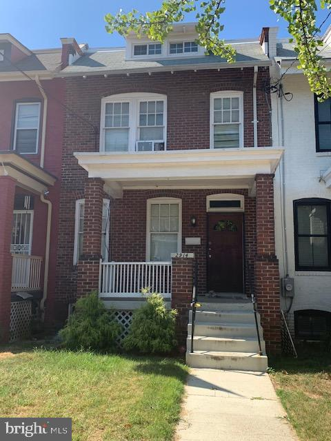 Price Adjustment! Spacious row house, wood floors, stainless steel appliances, off street parking in back, cute back yard. Located near Catholic University, public transportation, shopping and more. Sold As-Is. Don't wait this will go fast!