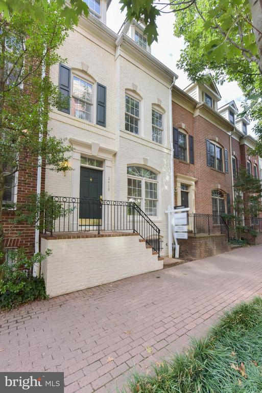 Open house Sunday 2-4 (11/10). The first three most important words in real estate, location, location and location. This exceptional 4 level townhome has it is own attached two car garage! The location provides an ideal lifestyle as you are minutes from the Clarendon and Courthouse neighborhoods. This luxury three bedroom, two and a half bath townhome has an open floor plan bathed in natural light, beautiful hardwood floors, and architectural elements such as the custom built-ins, and crown molding. The gourmet kitchen will delight the gourmet or everyday chef. Gorgeous granite counters, designer glass tile backsplash, a deep stainless-steel sink, stainless steel appliances will enhance meal preparation. The extraordinary Master Suite is located on the next level. Highlighted by a vaulted ceiling, oversized windows, and provides a light and open feel. The master bath features a large glass enclosed shower, a double sink, and soaking tub. Living in Courthouse Hill you~ll be minutes away from restaurants, retail, coffee shops, movie theaters, parks, and the Metro Orange Line stations.