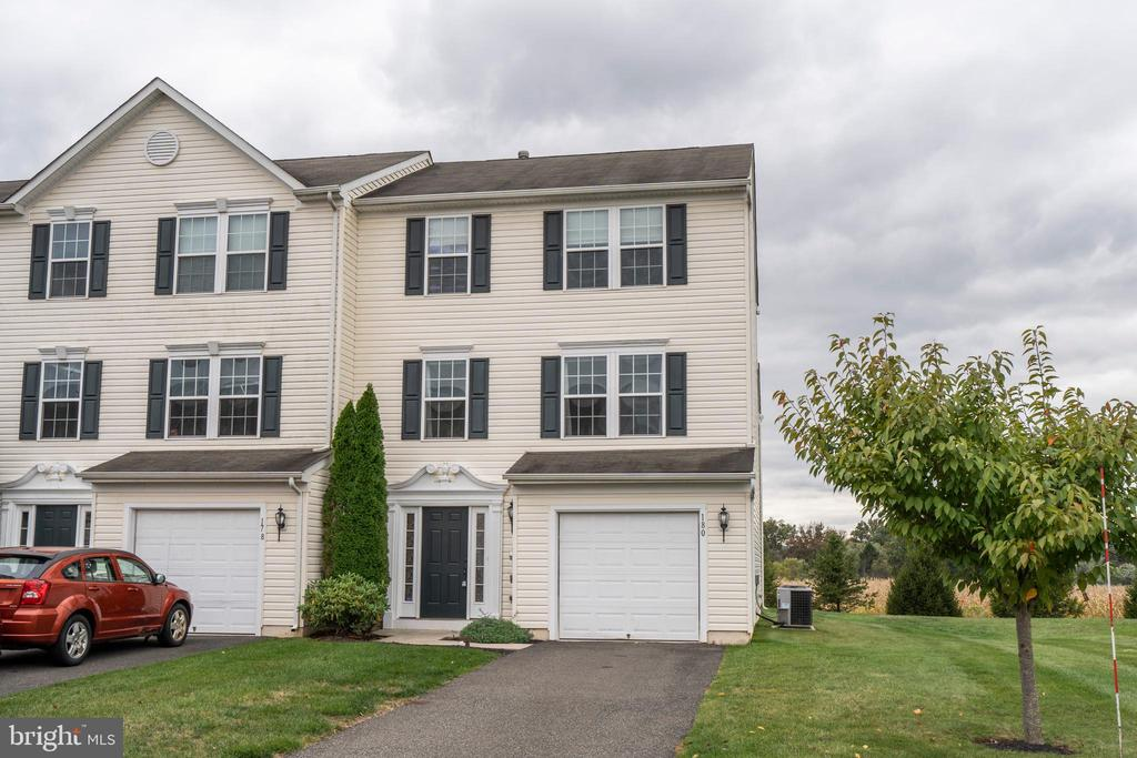 This end unit townhome, located in Coventry Glen has 3 bedrooms and 2.5 bathrooms. The main level consists of a spacious living room and an expanded kitchen and dining room. The kitchen overlooks a large open space, which is perfect for an entertaining area, playroom, office, etc. Large windows showcase the beautiful views and allow for plenty of natural lighting into the kitchen. Complete with stainless steel appliances and an island. Countertop space and cabinet storage are plentiful. A maintenance-free deck can be accessed from the kitchen. The ground level, perfect for a family room, provides a large, finished area with carpeting, a powder room, laundry area and access to the one-car garage and the backyard. The master bedroom and 2 other generous sized bedrooms are located on the upper level. The Master bedroom has a large walk-in closet and the master bathroom contains double sinks! This community has a playground and provides lawn maintenance.~