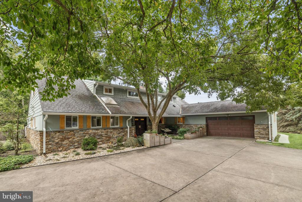 Meticulously maintained contemporary home on 2+ acres in much sought-after Lyon Acres.  Walk through the double door entry into the sprawling living room boasting wall-to-wall windows overlooking the pool, stone wood burning fireplace and recessed lighting.  French doors lead you to the impeccable dining room adorned with crown molding and gleaming hardwood floors.  Prepare gourmet meals in the opulent kitchen equipped with 42~ cabinets, leathered granite counters, Sub Zero cabinet paneled refrigerator, Jenn-Air cooktop, Thermodor double wall oven, granite sink, island and  planning station.  Enter the conveniently located main level master suite with luxurious master bath.  An additional main level bedroom and a second full bath awaits.  Three additional generously-sized bedrooms and two full baths complete the upstairs sleeping quarters.  A partially finished lower level is open to all possibilities.  Travel outside to the custom in-ground pool with accommodating pool house cabana with bar and full bath.  In-ground lawn sprinkler system. Relax and enjoy your private lot on the perfect, expansive patio.  Upgrades include: Interior/Exterior Paint, Stacked Stone on Exterior, Garage Door, Stone and Slate Hearth Fireplace, Cedar Shutters, Heat Pump, Solar Panels, Carpet, Granite Counters, Flooring. This remarkable property aims to please and is truly the embodiment of Maryland's good life