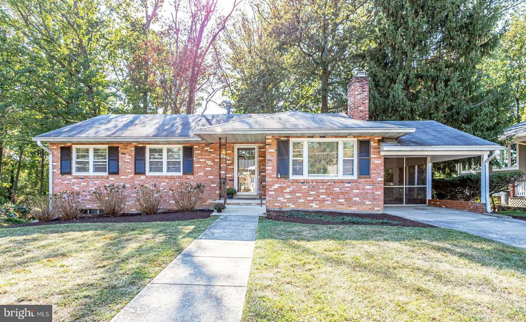 Enjoy putting your own touches on this charming rambler in Falls Church.  3BR+LL office/den with 2FBA/1HBA + carport+ deck+screened in porch. 2 stunning brick, wood burning fireplaces. Quarter acre lot with mature trees. Fresh paint+ carpet. New HVAC system. Timber Lane ES, Longfellow MS, McLean HS. 2 miles to WFC Metro. W&OD Trail close by. Sold as-is.