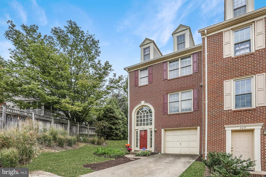 Grab this coveted end unit TH, tucked at the very end of a quiet street. Classic brick exterior with showstopping Palladian window, arching over a two-story foyer, leading to entry-level den or guest room. Upstairs, open concept LR/DR and fall-weather perfect woodburning fireplace. Adjacent pass-through window to an all white, gleaming kitchen. SS appliances, incl. french door fridge. Master Bedroom suite with huge walk-in closet. Extended rear deck w/ tall privacy fence for Friday night gatherings. Attached garage plus convenient guest parking. Enjoy the Quaker Hill community pool, and convenient locale tucked just off Duke Street and minutes from both 395/495 commuter routes and King Street and Duke Street Metro stops. Enjoy all that Old Town Alexandria has to offer just minutes away!