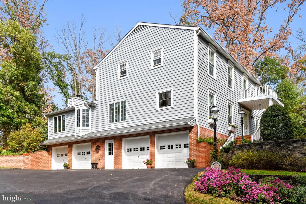 """To tour this Magnificent Home Online Please Click ON THE MOVIE REEL ICON LOCATED ABOVE THE PHOTO OR PASTE THE FOLLOWING LINK:  https://mls.TruPlace.com/property/237/77425/       .  Please call Mary Beth directly for your personal tour.      THIS IS IT!  Picturesque 4 BR. 3 BA, 3242 Finished SF Custom Colonial with Vaulted Ceilings, Walls of Windows, Gas FP,  Very Pretty Kitchen In Center of Home Open to Great Room with Vaulted Ceilings, Skylights, Walls of Windows and Gas Fireplace.  Owner Suite has 2 Walk In Closets, Ensuite Bath and Loft/Sitting  Area with Jetted Soaking Tub.  Relax in Your Very Charming Screened Porch Porch PERFECT for 3 Seasons.   New Trex Deck will Work Well for Entertaining with Plenty of Yard for Swing Sets and Sand Boxes.  Your 4 Car Garage Works Well for All of your Cars and Your Stuff Too! ENJOY your Very Large Driveway which Easily Parks up to 8 Cars!   Community Boat Slips, Pool, Tennis and Clubhouse.  Broadneck Blue Ribbon Schools.  Stop Looking--You have Just Found Your New Home!Renovations Include:  2019: New Washer and Dryer; New 22 x 20 No Maintenance Deck; Installed Last Zone in Multi Zone Irrigation System; Downspouts BUried.  2017:  Installed Plantation Shutteron on Anderson Windows; 2016:  Refininshed Hardwood Floors Throughout Entire Home; Complete Replacement of Upper Level Full Bathroom.  2015:  Replaced Windows Throughout Home-Anderson; Installed Whole House Generator.  2013:  Installed RHEEM Guardian Hot Water Heater.  2010:  Installed 35 Year Shinge Roof and 5"""" Gutters.  MAJOR HOME RENOVATION Includes the Addition of a Great Room iwth Cathedral Ceilings, Skylights, Walls of Windows, Gas Fireplace, Full Main Level Bathroom , Upper Level Loft with Jetted Soaking TUb, 2 Master Bedroom Walk In Closets, Lower Level Storage and 2 Additional Garage Stalls Resulting in a 4 Car Garage!  At this time replaced Existing Siding with Cedar Siding.  Added Front Porch and Reconstructed Screened Porch."""