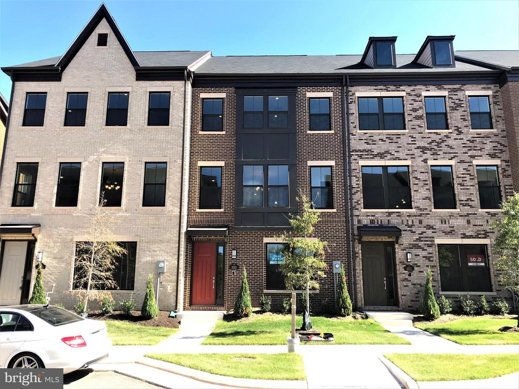 Beautiful brand new 4 level townhome in a fantastic location. 22' wide x 42'. Contemporary finishes include Stone Cabinets with Quartz countertops, backsplash and all upgraded appliances including a Hood, 5 burner cooktop, Convection Microwave oven + oven, and French Door Refrigerator. Main living level features open layout with hardwood floors and oak stairs. 3 bedrooms, with 3 baths and 2 powder rooms. Spacious loft with Two Sided Fireplace, Wet bar rough in and rooftop terrace! A must see. Prime location and close proximity to Dulles Airport, 28, 267, 50, 66, and short distance to Silver Line Metro!!!! Plus Closing cost assistance available with preferred lender. On site sales office is closed Thursday & Friday.