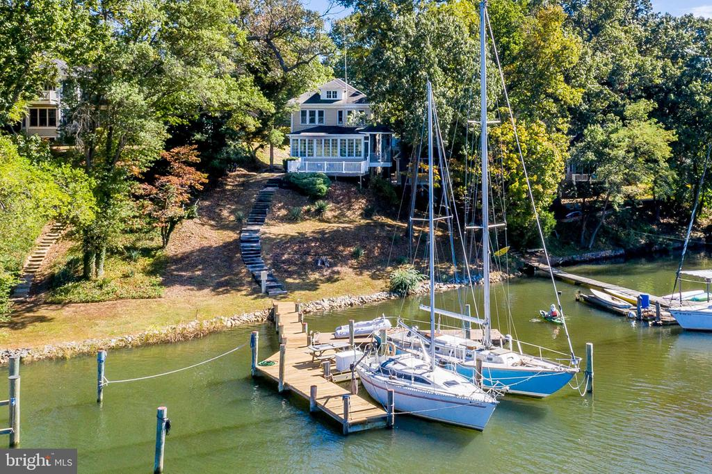 Two for one waterfront offering on Weems Creek in West Annapolis. The main house is a 1940 Four Square Classic Design recently improved while maintaining the solid authenticity and charm of the period. The home includes 3 bedrooms, 1 full bath, 1 plumbed half bath and 1 lower level bath. The main house showcases plaster walls, high ceilings, handsome moldings, wood burning fireplace, and hardwood floors throughout. The living room wall to wall windows overlook the large entertaining deck and gazebo with views of the deep water pier,  3 large slips and  approx 100 ft water-frontage .705 1/2 Arundel place is the  detached cottage with screened porch, and is an income producing studio or guest house for family and friends. Simply adorable.  Both properties are located on the furthest most point of land from the neighboring homes overlooking the protective waters of Weems Creek. The 28 X 25' garage  accommodates 3+ cars with ample off street parking for more. Walk to Navy games, West Annapolis Village shops, restaurants and markets. Minutes to Downtown Annapolis and quick access to Rt 50 if commuting to DC and Baltimore. Public records Sq Ft Incorrect.