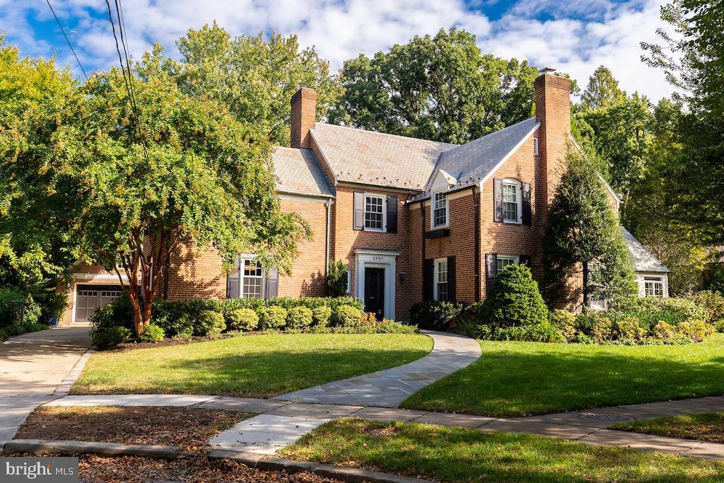 """Classic brick Chevy Chase home with slate roof,  separate 2 car garage  on a coveted  cul-de-sac .Features include large eat-in  chefs kitchen  which can seat 12,  along with  a 36"""" wolf range and full size Bosch oven.  Light pours in thru the 13 windows overlooking the 13,900. sq ft lot. Large family room with built in Mahogany bookcase. Dining room with French doors to flagstone patio. A large Living room with fireplace  leading to  a sun room.  Powder room and mudroom connected to both the front hall and back complete the 1st floor. Upstairs you'll find 4 bedroom 2 full baths ,hardwood floors throughout & 3rd floor suite includes bedroom ,full bath ,sitting area ,cedar closet and great storage. English basement with fireplace, laundry area and a surprise you must come to see."""