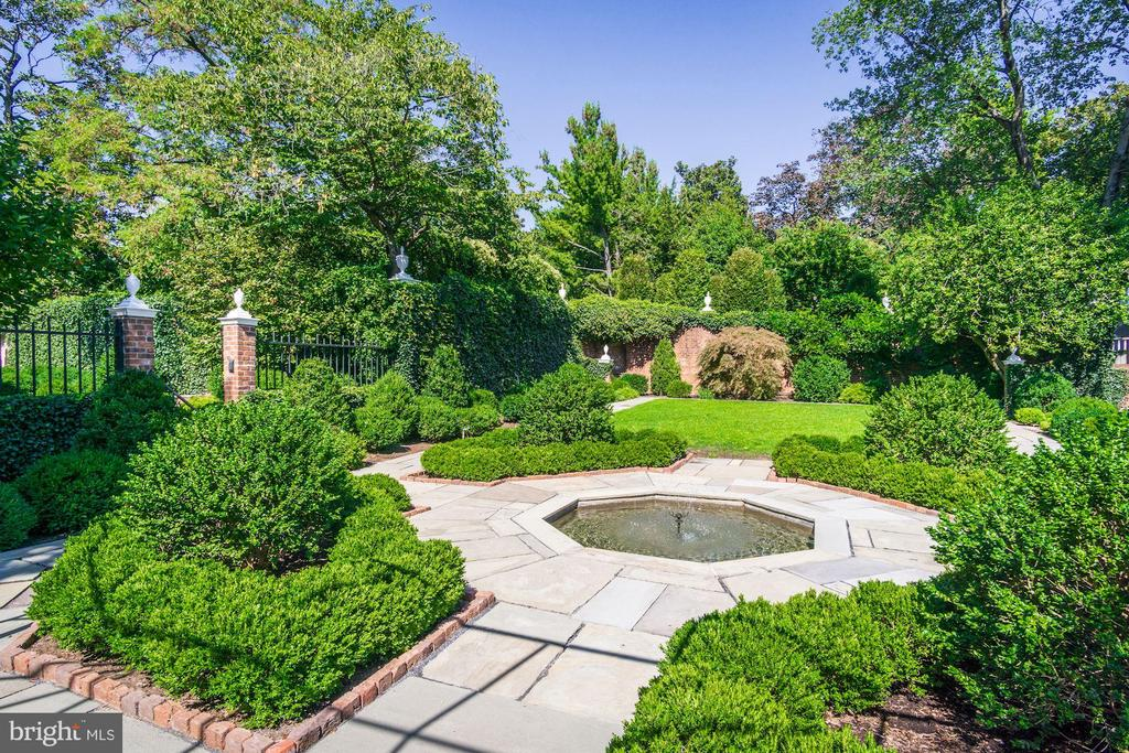 Just listed! Extremely rare and special opportunity in the heart of Georgetown! One of the few true estates in Georgetown! This property, which includes 11,100 square feet of living space spans over 0.68 acres of impeccably designed gardens, multiple out buildings, a pool, a parking lot, greenhouses and more. The 10 bedroom, 6.5 bathroom main residence features three stunning public rooms which include the parlor, library, and dining room, an orangerie, 12 fireplaces, impeccable moldings and historic details throughout. This property showcases a half acre of gardens include terraces, grand estate walls, a bowling green, large herb garden, and boxwoods originally designed by Rose Greely in 1930 and later updated by Perry Wheeler and Andrea Filippone. Additional highlights of this estate include an entertaining pavilion with large basement workroom, two green houses, a pool with pool house, two 2-car garages, a parking lot for dozens of cars which is accessed through an alley on N Street, and a four bedroom guest house. Showings by appointment.
