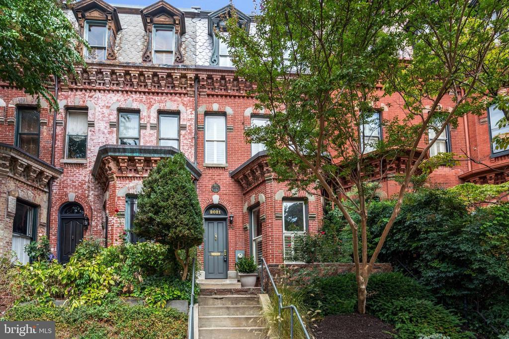Big, $100,000 price reduction for the new year.  Don't wait. This one will go!  Welcome to 2021 N Street NW, a stunning Dupont Victorian, steps to it all. Enter through the vestibule to the airy salon with handsome fireplace and lovely bay window, overlooking tree-lined N Street. The generous dining room features wine storage, and the updated kitchen is a chef~s dream, complete with gas cooking and top-of-the-line appliances. Off of the kitchen is a coveted two-tiered rear deck, the perfect place to enjoy your morning cup of coffee or evening night cap. A powder room completes this floor. Three bedrooms, three full bathrooms, and a convenient home office grace the two upper levels, and a two-car garage is accessed from the lower level, which boasts even more wine storage and plentiful closet space.