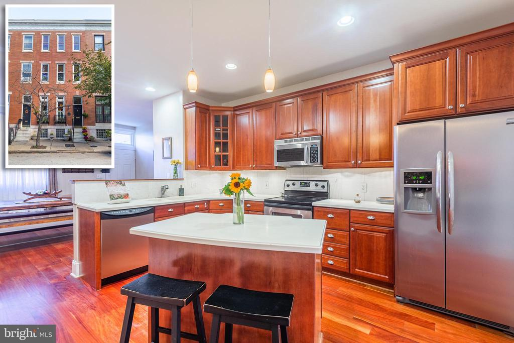 DESIRABLE PARK FRONT PATTERSON PARK ROWHOME THAT'S FULL OF MODERN AMENITIES & HISTORIC CHARM!  Over 1,900 sq. ft. of living space featuring hardwood floors throughout, inviting living living room w/ pocket French doors leading to the island kitchen w/ ss appliances, and separate dining area w/ exposed brick, 2nd level w/ 2 bedroom suites with full baths, 3rd floor Master suite w/ vaulted ceilings, 2 closets, private sitting room, and full bath w/ separate whirlpool tub & separate shower.   The rear garden patio w/ Pergola is the perfect place to enjoy Spring, Summer, & Fall nights and the best part is you have one of Baltimore's best parks right outside your front door!  This is truly city living at it's best!