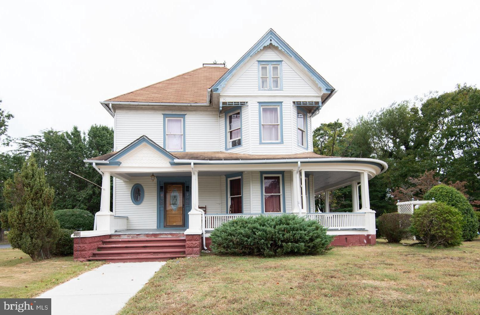 New roof to be installed prior to settlement   Victorian home with modern updates in kitchen and bathroom. Nice hardwood floors throughout.  Wrap around porch - recently painted.  Large corner lot and several outbuildings.