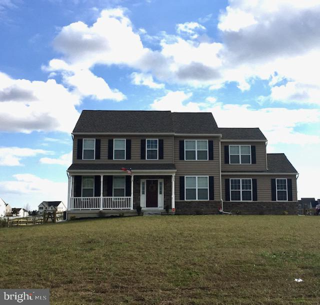 "Dilsheimer Communities are building in the very popular new home community of Jockey Hollow. The Jefferson model is a great 4 bedroom - 2 1/2 bath plan with a full basement and a 2 car side entry garage. Formal living room and dining room. Fully equipped large eat-in kitchen with granite countertops, quality wood cabinets and GE appliances including a ""SpaceSaver Microwave"". Gathering room features a gas fireplace and wall to wall carpeting. Owner's suite has a cathedral ceiling, walk-in closet and sumptuous bathroom."