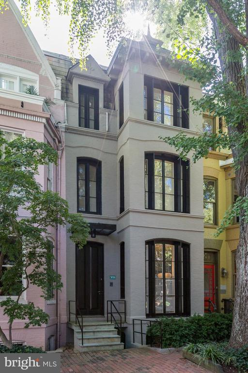 A reimagined Victorian by famed architect Hugh Newell Jacobsen on one of Georgetown's prettiest streets. Four floors of special architectural touches reached by a signature staircase invite your appreciation or adaptation. Large windows, wooden floors and tall ceilings give a feeling of spaciousness. Four bedrooms including a play loft, and 3 full and two half baths provide for comfortable living.   A small pool water feature in the back garden opens the space for visual enrichment and enjoyment. Conveniently located within minutes to the many amenities of Georgetown including shopping, restaurants, the university, parks and the library. Nearby public transportation takes you downtown or uptown.    Easy highway access to Virginia and Maryland and beyond.