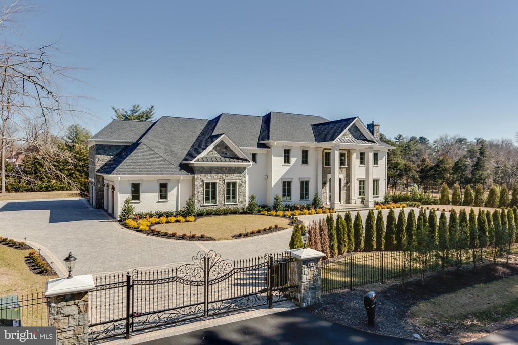 HUGE PRICE REDUCTION!! Motivated seller. Inspired by great European manor homes, this spectacular new estate is ideally located in prestigious Langley Farms, just minutes from Washington and developed by world-class, ALM Builders. Behind scrolled wrought-iron gates at the corner of Dolley Madison Boulevard and Ballantrae Lane, an incomparable Manor has been built that re-defines the image of pure opulence and luxury. Every square inch of this magnificent home has been fashioned, designed, and enhanced beyond all expectations. It is an incredible abode filled with breathtaking details and appointments combined with luxurious ambiance that surrounds every sense. Huge windows overlook the Versailles styled pool and plazas. Towering ceilings rise to gothic vaults, a twenty-five-foot dome, crowned coffers, and lighted trays. Intricate trim-work accent every room with architectural lighting, gleaming woods, the most beautiful crystal, and artistically forged scrolled iron. There is an elevator, an esquire~s library, an embassy sized dining room with separate cordial salon, a vast show kitchen with a connecting cook~s kitchen, world-class bedroom suites, and a master~s domain as large as a private house! The club level is beyond belief with its interconnecting rooms designed for ultimate entertaining as well as relaxation. Including a round party room, a large club room, a central bar, vintner~s wine cellar, gym, sauna, and state-of-the-art theater. In-ground heated pool, Pavilion, and Pergola. This house rests on one of the last open lots in Ballantrae which is renown as being one of Virginia~s most illustrious neighborhoods home to some of our most famous citizens.