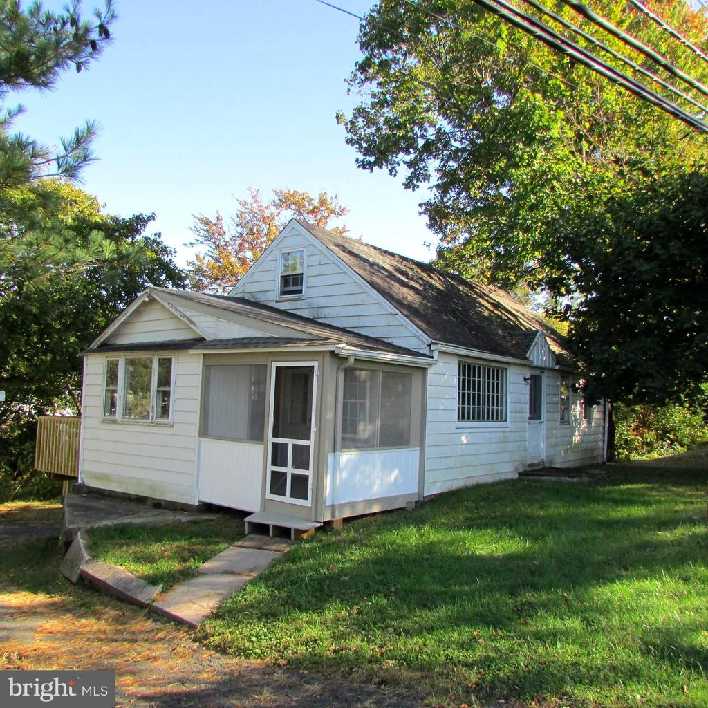 """Res. 2 Zoning, or Commercial C-1. (Village Commercial) Conveniently located off of Rte. 724 behind Coventry Mall. Potential Great Investment for complete makeover. Many C-1 uses. Call agent for list. Also could once again be used as Rental. Or; Why Pay Rent to a landlord? You could OWN your own Home for approximately the same Cost per Month! 2 BR, 1 Bath, L.R. Dinette, Kitchen with all New Cabinets, Countertops, (Buyer has choice of cabinet hardware) Breakfast Bar, New Sink, New Stove and Refrigerator. There is also a New Screened in Porch and a New Deck off of the Dinette. 2 BR's which share a Large Walk-In Closet. (Access from smaller BR and the Hallway) Remodeled Bathroom. Fresh Paint throughout. Walk-Up Floored Attic which gives plenty of Storage or could be converted to 2 more BR's. Full, Dry Basement for More Storage, or could be Finished. Nearly new Hot Water Heater, Heat system serviced in 2017. Two Windows and Walk-Out to Ground Level. One Car Garage with extra depth. .39 Acre with Small Stream in rear. Being sold as both Residential and Village Commercial. Commercial MLS# is: PACT491298 . Inspections welcome but, Home Sold """"As-Is."""" Showings through Showing Time."""