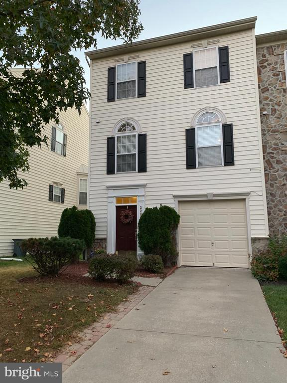 """Beautiful 3 bed, 2.5 bath townhouse in Waverly Woods. Large living room, composite deck off family room, kitchen with island, 42"""" cabinets, granite countertop, finished lower level rec room, walk out basement leading to patio."""