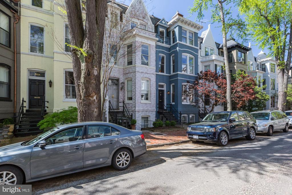 GEORGETOWN - East Village rowhouse w/ Secure PARKING on a picturesque one-way street. Almost 20 feet wide, this well-maintained home boasts a floor plan that lends itself to entertaining both inside and out. Updated Kitchen. Hardwood floors. Three separate outdoor spaces. 4 bedrooms, 2 full baths, 1 half bath. Lower level could be a nanny suite or leave as playroom/den. Walk to Montrose and Rose Park.