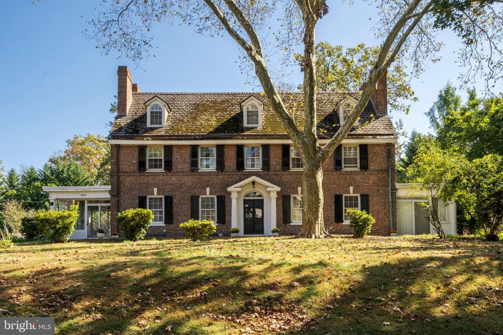 Character and charm are found throughout this stately brick Colonial located on a desirable tree lined street. Enter into the large foyer/living room with exposed beams, hardwood floors, an attractive brick fireplace, and glass French doors leading out to the back patio. The family room, with built-ins and marble fireplace, is connected to one of two sun-rooms on the first floor. The dining room, with handsome moldings and a fireplace, has two sets of French doors which provide access to the second sun-room. A butler's pantry, with back stairs to the second floor, along with the spacious eat-in kitchen and rear mud room, with a half bath and laundry, complete this level. A beautiful main staircase with moldings, and convenient coat closet leads to the second floor. The second floor boasts four sizable bedrooms, all with decorative inlaid hardwood-floors, two full bathrooms and a master suite with a marble fireplace and en-suite full bath. The third floor consists of two spacious rooms, one of which could be a perfect office, study, or au pair suite, and large full hall bathroom. The property features a 3-car carriage house with office or artist studio above, a large level backyard and wonderful flagstone patio. Conveniently located. the home is within close proximity to Cynwyd Park, R6 Cynwyd train, Cynwyd Heritage Trail and Bala Avenue shops and dining. Easy access to Center City Philadelphia!