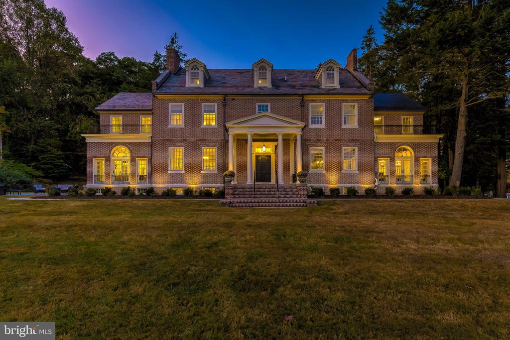 Incredible 1927 Historic Mansion revival with an unrivaled pedigree as the beloved home of the family of Edgar Allan Poe for over 70 years and the 2018 Baltimore Symphony Designers' Show House. Thoughtfully designed to blend stately and timeless architectural remnants with luxe modern amenities, this one of a kind estate has been transformed into a modern day masterpiece. Follow the long tree lined entrance drive and you'll find the enchanting Flemish Bond Red Brick mansion atop a small Knoll overlooking its nearly 13 acre plot. Inside you are greeted by 10+ foot ceilings, refinished original Heart of Pine Hardwood Floors and early 1920s Millwork. Elegant arched doorways invite you to explore each room of the house that store the memories of lives lived long ago. An original hand tiled morning room with tranquil views of the grounds showcases Inlaid Raven tiles- playing homage to the great Baltimore Poet. Modern amenities include new 6 Zoned HVAC, Electric, Plumbing, Windows and Natural Gas Line, renovated and expanded Kitchen with Blanco Halcyon Marble counters, Shiplap and Beamed ceilings, Viking Appliances, Dual Sided Gas fireplace and a custom metal Range Hood hand welded by Local artist Randy Slaysman. Incredible Master Suite with custom walk in Closet and 5 piece En-suite Bath. Wheelchair accessible Elevator & Gym space have also been added. In the basement, Original Arched Brick foundations walls help define a billiards room, entertaining space, bar, media room and 900 Bottle Wine Cellar. Exterior landscaping incorporating brick vestiges that once housed formal English Gardens help to create perfect outside entertaining spaces. A newly built 3 car garage with interior breezeway connects home and car while a whimsical walkable bridge leads guests from the main house to a separate guest suite. The ultra coveted Greenspring Valley location is conveniently centered between all major commuting routes- I95, I695, I83, Falls Rd- a short trip to Green Spring Valley Hunt Club and to a large selection of shops and restaurants. VISIT www.416GarrisonForest.com FOR MORE INFORMATION