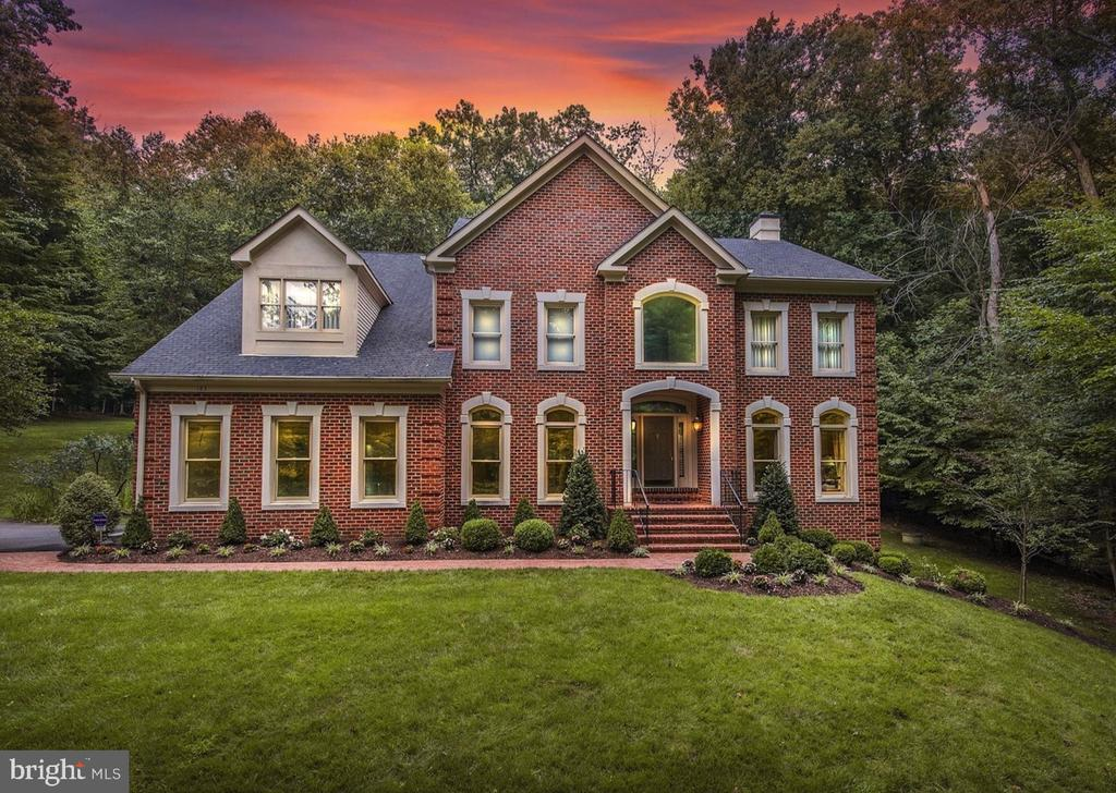 AMAZING PRICE! A TRULY RARE FIND. This stunning gem in Riverbend Knolls with over 6100 SF! On a quiet no-through street, don't miss this 5BR/4.5BA brick Colonial on 1.7+ acres of beautiful and secluded property! Neighborhood trail leads to Potomac River & Riverbend Park, and is less-than-a-mile to Riverbend Country Club! Fabulous living space including elegant two-story foyer, gourmet eat-in kitchen opening to the dramatic two-story family room with elevated ceilings, tall light-filled windows & fireplace. Master suite w/ sitting room, two walk-in closets, and gorgeously remodeled bathroom. Recently finished lower level with 5th bedroom, updated full bathroom, large recreation space and wine cellar. Two-tiered deck with beautiful private wooded views. Brand NEW roof with transferable warranty! There is so much to love about this fabulous home in an idyllic retreat setting! This sought-after Great Falls neighborhood is close to the shopping and dining at Great Falls Village, is an easy commute into DC or Maryland and is located in the Langley School district.