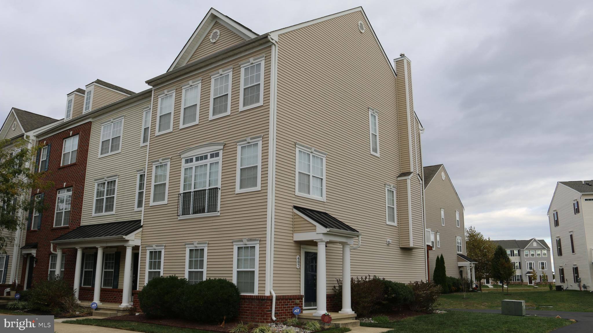 Welcome to our listing at 407 Toftrees Dr. in Middletown Delaware.  This lovely and stylish 3 bedroom 2 Full, 2 half bath end unit town-home located in the Appoquinimink School district features a ton of desirable amenities you're sure to love such as....A beautiful corner lot, rear facing garage, full finished basement with box trim and recessed lighting, tasteful neutral paint and carpeting, large kitchen with abundant counter space open to the family room.  42 inch maple cabinetry, stylish black appliances, 9 foot ceilings, a formal dining room, tuck-away staircase, party deck, spacious master retreat with walk-in closet and master bath, spacious secondary bedrooms, and much more.  This home is walking distance to many popular locations for shopping, dining, and entertainment.  If you're looking for a home with a fantastic combination of affordability, accessibility, and convenience, look no further!