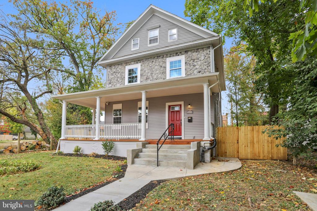 Walk up to the wrap around front porch before entering your new home. Renovated and Ready for you to tour, This home features laundry on the master bedroom level, open floor plans and a lower level ready for entertaining.  Spend time in your master bedroom suite, your open kitchen or near the fireplace this winter. The tall ceilings, recess lighting throughout, brand new energy star efficient windows, fully finished basement and large backyard are just a few of its many amenities. Make this house your home TODAY.