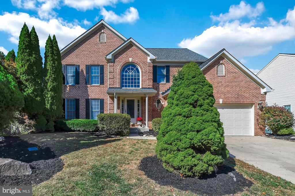 WELCOME HOME TO THIS 4BR/3.5BA BRICK FRONT COLONIAL IN A HIGHLY COVETED, RARELY FOUND LOCATION BACKING TO THE GUNPOWDER STATE PARK! NEWLY REMODELED WITH RICH, WIDE PLANK FLOORING FLOWING THRUOUT THE ENTIRE MAIN LEVEL. GORGEOUS UPDATED EAT-IN KITCHEN W/DUAL ISLANDS, GRANITE COUNTERS & SS APPLS. KITCHEN OPENS TO THE FIRST FL FAM RM W/FIREPLACE & A SUNLIT BREAKFAST AREA W/FLOOR TO CEILING WINDOWS. TRUE 4BR W/ALL 4 BRs UPSTAIRS INCL MBR SUITE W/SITTING AREA, WALK-IN CLOSET & BRAND NEW MASTER BATH (CUSTOM GLASS SHOWER DOOR HAS BEEN INSTALLED - NOT SHOWN IN PICS). FULLY FIN'D WALKOUT LL W/GAME ROOM, SITTING AREA, SEP DEN/PLAYROOM, FULL BATH & BAR. IN-LAW SUITE POTENTIAL! FRESHLY PAINTED & NEW CARPET UPSTAIRS. LARGE DECK & EXTENDED PATIO OVERLOOKING THE PARK. 2 CAR GARAGE, YOUNG ROOF & HVAC, END OF COURT LOCATION & MORE! **COLORS ARE A BIT LIGHTER IN PHOTOS THAN IN PERSON** AGENT IS OWNER.