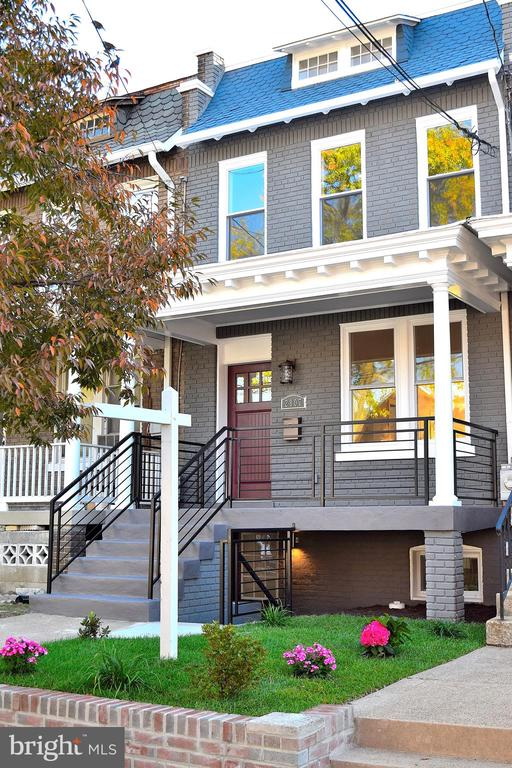 Enriching elements with practical features: 2 living areas with a center island Gourmet Kitchen gives you the option for a formal LR and DR or combined living & dining with Family Rm & 1/2BA. The rear exit leads to the deck & green yard w/2 car Garage door parking. The 2nd Lvl offers a front facing MSB Suite, Laundry, 2BRs & hall bath w/soaking tub & skylights. The lower level has front & rear access which gives you the option for a 2nd Family Rm, 2nd Kitchen, 4th BR & 3rd full BA - OR - An in-law suite - OR - An income producing accessory dwelling unit. Enriching elements that gives you options makes this a capital investment.
