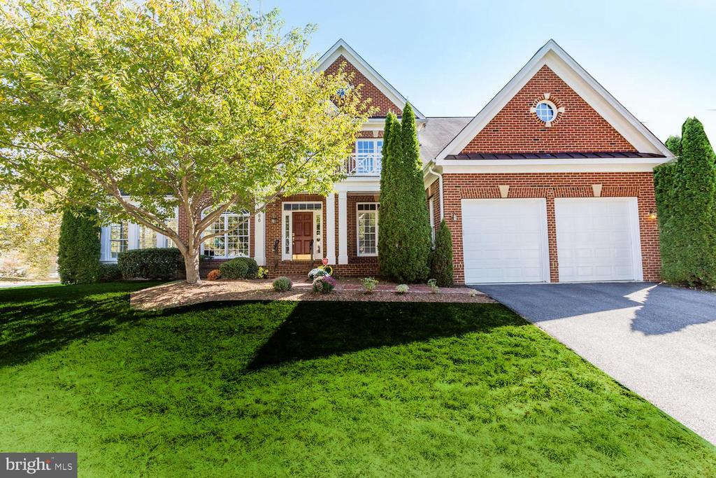 Substantial 6 BR, 5.5 BA Manor Home in  popular Kingsport with community pool, playground and water privileges providing over 6200 sf living space, an extensive open floor plan, two Kitchens/Master Suites/Laundries, surround sound and upgrades galore.  Perfect for today's need for separate living spaces with 2 homes in one: 2000+sf Lower level features full new gourmet granite Kitchen, Laundry, Living Room, 2nd Master Suite/BA/Closet, 2 Bonus Rooms and outside access and patio, high ceilings and custom wood flooring. The main home has 4200+sf and features renovated granite Kitchen & Breakfast Room, two-story Family Room with Gas Fireplace, formal Living and Dining Rooms, Sunroom extension, Home Office and main floor BR/full BA.   Upper Level features oversized Master Suite with Gas FPLC, SuperBath and separate closets. 3 additional  Bedrooms, one w/ ensuite BA and two BR's share a jack/jill BA. This home is a must see! Summers are spectacular in Kingsport with grand pavilion, community pool/spa, playground and nearby lake for kayaking. Lots of clubs and community festivities.  Close to everything Annapolis has to offer and just off Rt. 50/97 and 30 mi to Baltimore/DC region.