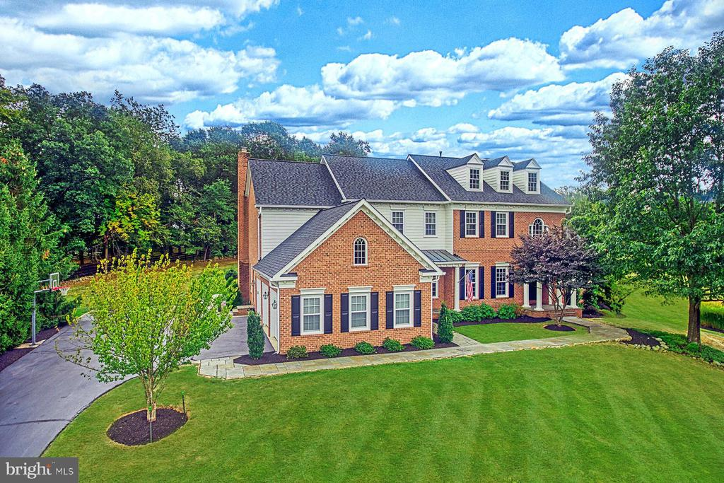 Perched on an elevated three-acre estate lot in Beacon Hill, this home showcases glorious views over the surrounding countryside along with timeless elegance and stunning style. This expansive all-brick custom residence was built by Yeonas & Ellis and is guaranteed to amaze a wide range of buyers. The layout has been carefully considered to offer both formal and informal living zones, all with new oversized windows that draw in natural light and perfectly frame the picturesque surrounds. Set just off the grand entry is the formal dining room, the perfect place to host guests and admire the charming wainscoting and updated chandelier while the living room is warmed by a cozy gas-burning fireplace. In the center of the layout sits the gourmet eat-in kitchen complete with a suite of stainless steel appliances and a large island. The home chef will love the quartz countertops and ample cabinetry including a walk-in pantry plus the kitchen has also recently been painted. From here, you can overlook the open family room, also with a gas burning fireplace, while a light and bright sunroom, a formal sitting room and an office with French doors complete the main level. Hardwood floors flow throughout and draw you through towards the large bluestone patio where you can host guests and take in views over the picturesque property with lush lawns and mature trees. Inside, dual staircases lead to the upper level which houses four bedrooms including the expansive master suite. Fit for a king, this executive master boasts hardwood floors and a light-filled sitting area along with two large walk-in closets and a luxurious master bath with a soaking tub, dual vanities and a large shower. The remaining bedrooms also have ensuite bathrooms, two feature walk-in closets while one has a built-in closet plus there~s a study on this level. The fully finished basement offers a rec room with a wet bar, a fifth bedroom with a walk-in closet and an ensuite plus there~s a media room, a huge storage area and access out to the rear patio. A three-car garage, updated paint, a new roof, generous closets and new light fixtures only add to the appeal of this impressive and beautifully appointed home.This beautifully appointed estate home is in the prestigious community of Beacon Hill, located in the heart of Loudoun County Wine and Hunt Country, just west of Leesburg, Virginia.  Beacon Hill is home to many senior business executives, professional athletes, physicians, attorneys and other professionals.  This exclusive luxury home community is nestled on the rolling crest of Catoctin Mountain. Encompassing 1,100 acres, Beacon Hill is home to 225 estate and hamlet homes, surrounded by horse trails and breathtaking open space that offers beautiful views of the Blue Ridge foothills.   Once a private estate owned by 1950~s radio host Arthur Godfrey, Beacon Hill offers a unique blend of private country living with easy access to diverse employment and shopping opportunities in Loudoun County.  Beacon Hill is just 15 minutes from Dulles airport and an easy commute into Fairfax County and Washington D.C.