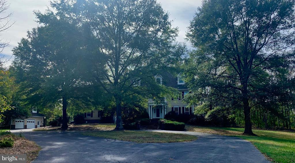 This is a diamond in the rough. The home is 5467 +/- sq ft above ground so much potential on 5.15 acres with inground pool (as is a condition) Walk in and see the wonderful huge sunroom overlooking back. Upper-level Owner's suite has his/her separate master baths with additional exercise/office and a deck with master only access lower level with more finished space, bedroom, full bath, exercise or media room this home goes on and on