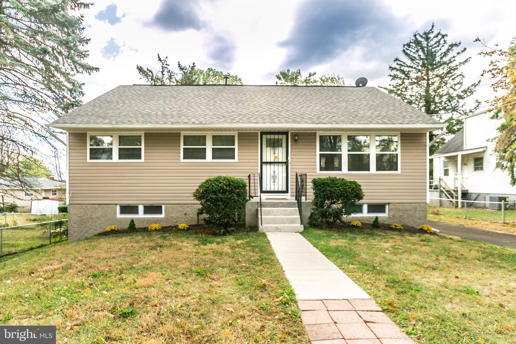 Welcome Home to your new Charming Raised Rambler in Catonsville Manor. Come and see this loving and exceptionally well-cared for home that is ready its new owners. This unique home features 8 spacious bedrooms and 3 full bathrooms. Lower level, includes complete kitchen with living quarters /entertaining area, laundry room, 1.5 bathrooms, three bedrooms with separate outside access. Ideal space for an In-law suite or Income producing opportunity. Main floor boasts loads of natural light, original hardwood floors, open kitchen with new stainless steel appliances and lots of cabinet space.Start your day off with a cup of Joe on your new covered deck enjoying the subtle sounds of nature from your well manicured back yard.