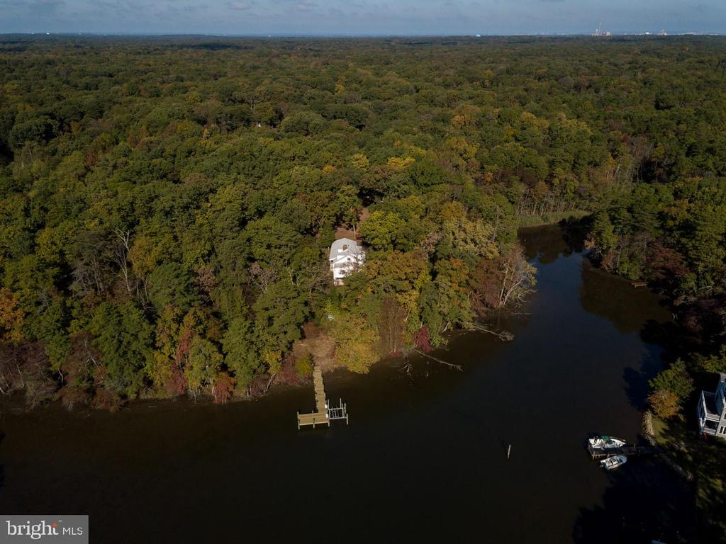 Beautiful 5 Acre Waterfront 3 Bedroom 3 Full Bath Cape Cod located in Chesapeake School District. Private setting overlooking Black Hole Creek off of the Magothy River. Newer HVAC system installed with Heat Pump. Brand New Decking installed on pier with Boat Lift.