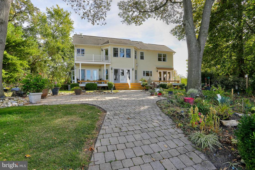 Custom deep water waterfront home located on Back Creek of the Bodkin near the end of the Poplar Ridge peninsula.  100' of shoreline. Multi wide slip pier with 20K lb lift, 12k lb lift, and 2 pwc lifts, Typical 8-10' depth and less than 5 minutes to the Bay. Extensive pavered patios for entertaining. Covered detached 2 car carport plus multi vehicle parking on extensive pavered driveway and parking area. Constructed in 2005, home boasts large rooms and many upgrades throughout.  Greatroom with gas fireplace and adjoining formal dining area. Eat in kitchen with granite counters and cutom cabinetry opens onto the family room. Main level half bath and separate large laundry room.  Second level owners suite with super bath. 2 additional bedrooms and full hall bath.  Home is under contract contingent upon home sale. Contact Co LA directly with questions. Photos soon