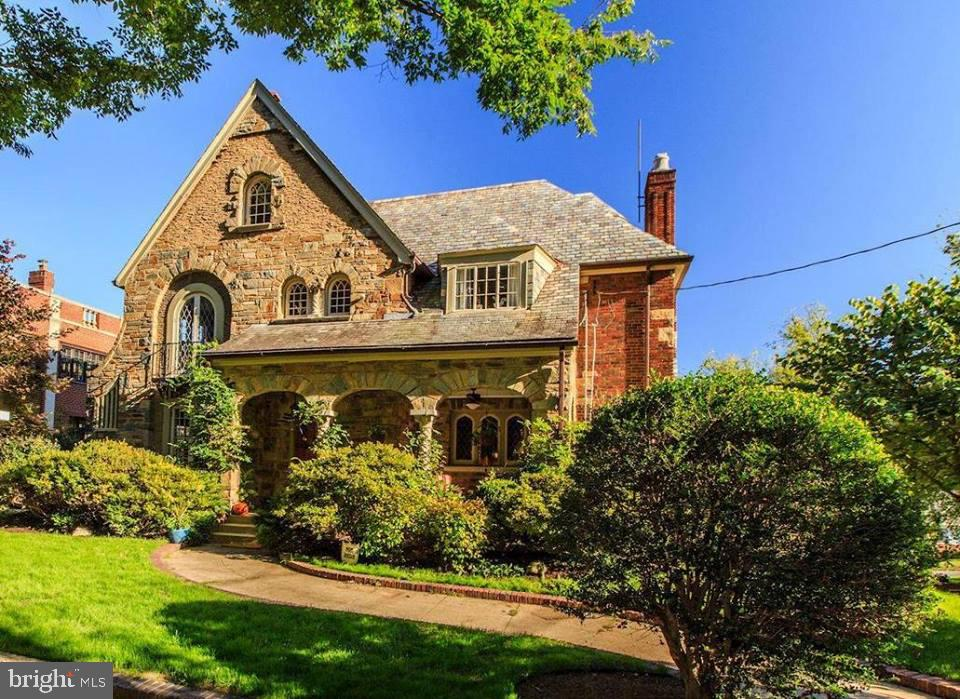 CRESTWOOD:  This classic 1929 stone and brick Tudor Revival home is located on a tree lined boulevard  overlooking Rock Creek Park, steps to 16th Street and Carter Barron.  Enjoy stress- free urban living, just 20 minutes from National Airport, Kennedy Center, shops and restaurants of Georgetown, Logan and Dupont Circle.  This home has been painstakingly renovated and reconditioned with much of the original architectural trim, hardware, original leaded glass doors and windows.  Grand three level home includes 5/6 bedrooms, 3 full and 2 half baths, large and renovated chefs  kitchen.  Over-sized two car garage.