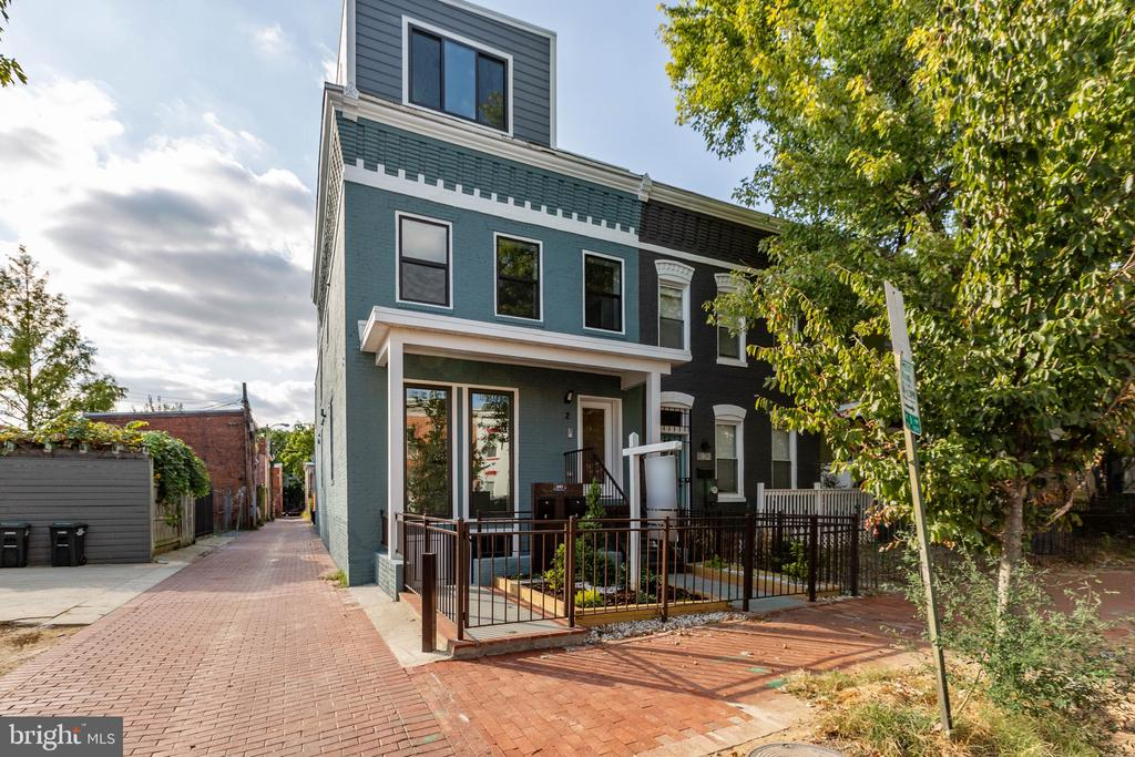 Welcome to 910 9th ST NE #2 condominium. This newly renovated semi-detached 2-unit condominium is just 1 block from the very vibrant H Street Corridor and 4 blocks from Union Market, which provides a plethora of restaurant, bars, shopping centers, coffee shops, and grocery options. #2 is a 4 bedroom 3 1/2 ~ bathroom unit with 3 bedrooms and 2 baths on the first level, with a washer and dryer. #2 first level master bedroom comes with a huge master bathroom with a shower and bathroom tub, large walking closest, and stunning natural lights. The second floor is a must see work of art with the Kitchen your dreams, which  includes Quartz counter tops, Kitchenaid appliances and a wonderful island with a side deck to die for. The Open Floor Plan ensures ample entertaining space, while the surround sound speakers provide the ambiance for entertaining guest, as well as outside speakers.  The unit also comes with hardwood floors throughout, and parking for each unit in the rear.  910 9th ST NE  #2 has a walk score of 94.