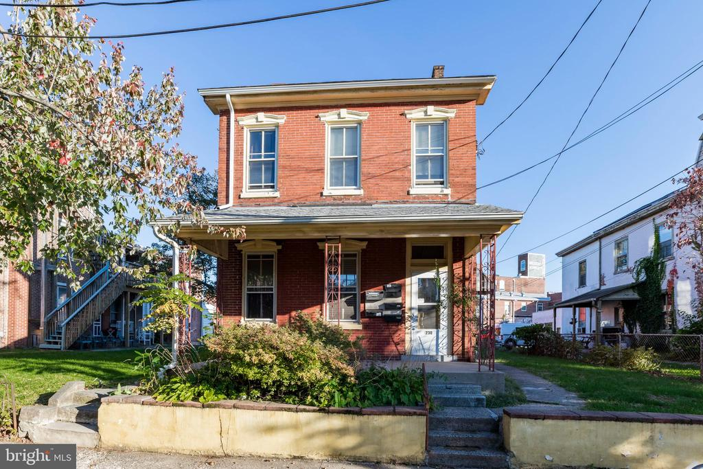 Four unit property in the heart of Pottstown with excellent rental income history now available to add to your investment portfolio. Four well-maintained two-bedroom apartments and two garage units rented under market value bring in over 40k a year with additional income potential. Schedule a showing today!