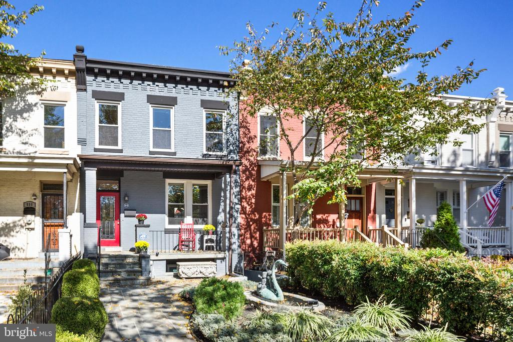 Amazing new price and Open Sunday, 1-3 pm! Come see the new look! Painted throughout, kitchen refresh, and more improvements! A local builder's home extensively renovated since 2008. Beautiful K ST location with quick access to NoMa Metro, H ST Corridor, Capitol Hill, Union Market, and 395 to Amazon's National Landing. Walk up to the professionally landscaped garden, custom stone pavers, to the lovely  front porch. Inside you will see the stone wood-burning fireplace, gleaming hardwood floors, half bath, and open well-appointed kitchen. Step out to the rear paver patio with storage shed, modern privacy fence and parking potential with simple adjustments. Upstairs features three spacious bedrooms and one generously proportioned bathroom. The large south-facing master bedroom boasts ample space to add an en-suite bath. Downstairs includes an incredible lower level in-law suite or potential money maker! Completely built-out in 2013 and configured as a 2 bedroom / 1 bath with new kitchen, full laundry, open living dining space, 8'+ high ceilings, large windows, recessed lighting, fireplace, mitsubishi HVAC systems, and front & back egress. Opportunity knocks to rest easy!